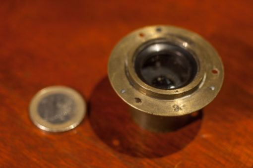 Small Brass lens from the 1900s with mounting flange